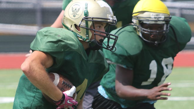 Franklin D. Roosevelt High School's Nick DiCarlo carries the ball during a drill at preseason practice on Thursday.