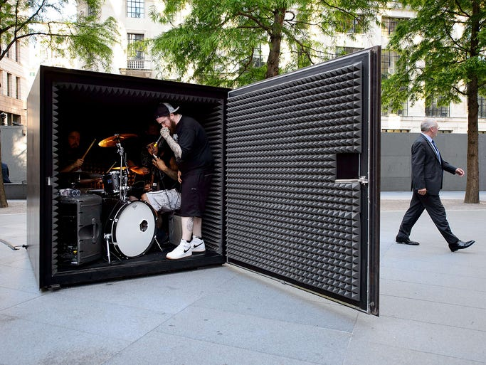 """Members of the death metal group Unfathomable Ruination warm up on July 3 before performing inside an air-tight metal cube in London. An installation entitled """"Box sized DIE featuring Unfathomable Ruination"""" is an art piece by Portuguese artist Joao Onofre. The band is sealed inside the box and plays music until their oxygen supply runs out."""