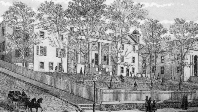 This 1860 print of Augusta Female Institute clearly shows the stone wall/picket fence arrangement at the front lawn meant to discourage local boys from flirting with the girls.