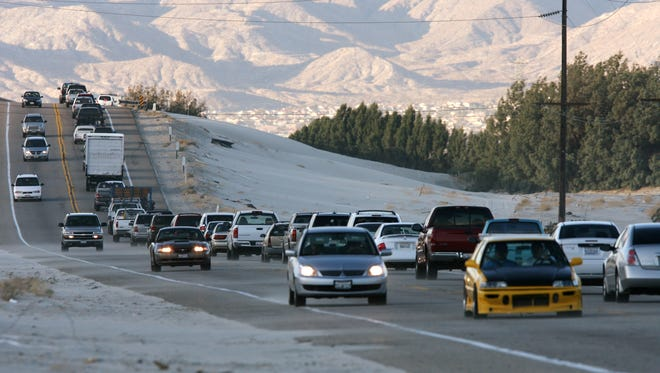 All roads closed after heavy rains touched down on the Coachella Valley and led to flooding in Palm Springs were reopened Saturday, police said.