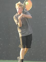 Abilene High's Dylan Haught hits a backhand during a previous match last season