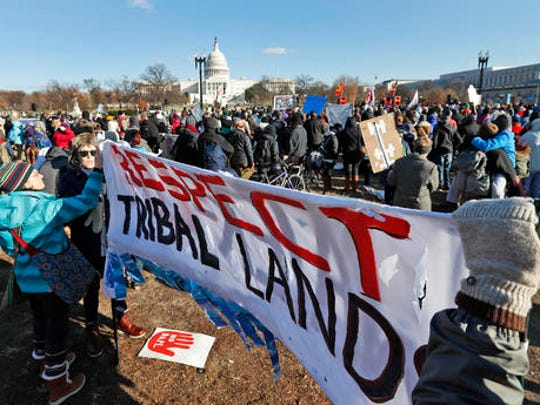 Demonstrators gather on Capitol Hill in Washington, Saturday, Dec. 10, 2016, to protest the Dakota Access oil pipeline. A federal court battle over whether the developer of the pipeline can finish the $3.8 billion project will linger at least into the first couple months of the new year.