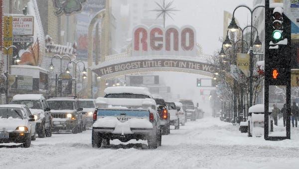 Traffic travels under the Reno arch Monday Dec. 7, 2009 during a snowstorm.