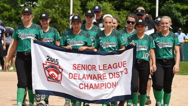 Delaware District 3 Senior League champions march in the opening ceremonies of the Softball World Series at the Pyle Center near Roxana.