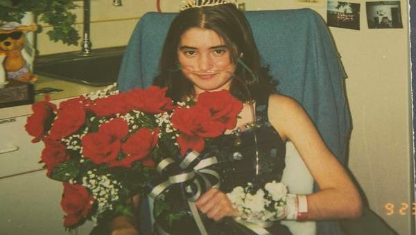 Emily Markert received the honor of homecoming queen Sept. 23, 1999, from a hospital bed after receiving a double lung transplant from living donors, a rarity at that time.