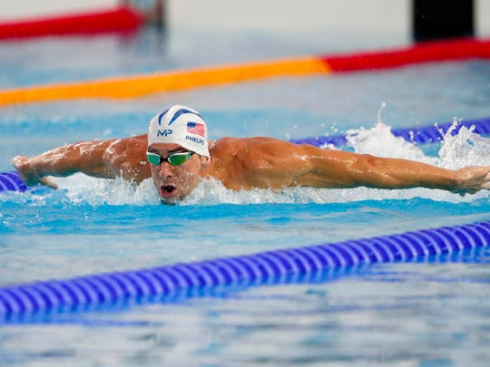 Michael Phelps (USA) swims prior to the start of the