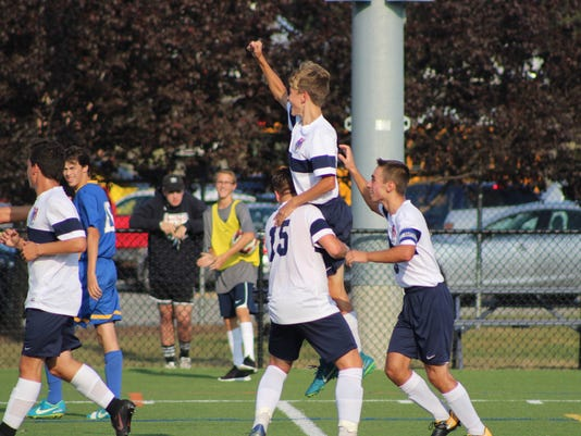 636455839784756067-Boys-Soccer---Joey-Carbone-5-being-held-up-by-Dan-Kaynak-6-and-Dylan-Quigley-15---Patrick-Maloney.jpg