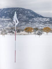 Snow covers the Cedar Ridge Golf Course in Cedar City
