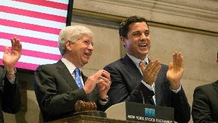 Gov. Rick Snyder, left, rings the opening bell at the New York Stock Exchange on May 8, 2015, in New York.
