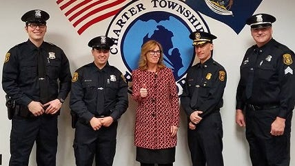 Two new Redford Township police officers were sworn in Monday, while a 20-year veteran was promoted. From left are new Officers Stefan Bero and Seth Ramirez, township Supervisor Tracey Schultz Kobylarz, Police Chief Eric Pahl and just-promoted Sgt. Jeff Bero. Jeff and Stefan Bero make up the first father-son duo in the history of the department.