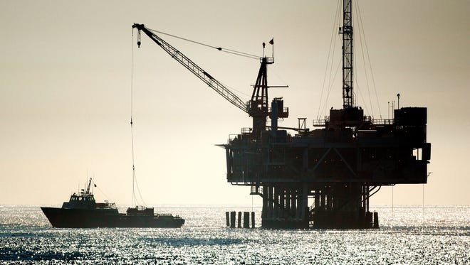 An oil drilling rig is seen off the coastline in this file photo.