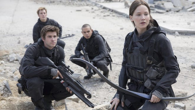 """Evan Ross (c), Jennifer Lawrence, Liam Hemsworth  and Sam Claflin in a scene from """"The Hunger Games: Mockingjay - Part 2."""""""