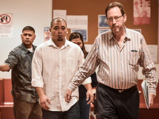 In this Nov. 9, 2016, file photo, Jaycee Aaron White, center, leaves the courtroom with his attorney, F. Randall Cunliffe, right, at the Superior Court of Guam's Northern Court Satellite in Dededo.