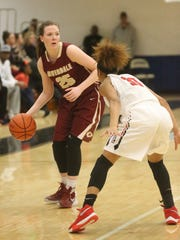 Riverdale's Alexis Whittington looks for a teammate to pass to during the Region 4-AAA championship.