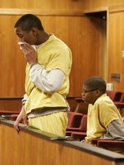 Thomas McCloud wipes away tears as he is sentenced to life in prison in Oakland County Circuit Court in December 2009. McCloud and Dontez Tillman (seated, wearing glasses), were both 15 when they were convicted as adults with murder and sentenced to life in prison.