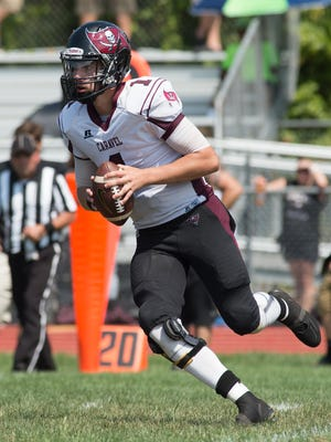 Caravel QB Alex Barker (1) looks for a receiver against Concord on Saturday. The senior threw three touchdown passes in the first half, but suffered a fourth-quarter ankle injury that will likely end his season.