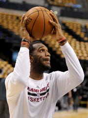 Miami Heat center Greg Oden goes through pregame warmups
