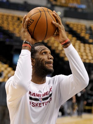 Miami Heat center Greg Oden goes through pregame warmups prior to the game against the Indiana Pacers inside Bankers Life Fieldhouse, Wednesday, March 26, 2014, in Indianapolis.