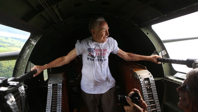 World War II veteran John Herrmann from Colerain Township looks out the window of the Liberty Belle during a ride in the B-17 bomber airplane, which has been painted to look like the famous Memphis Belle  that flew in World War II.  Herrmann flew 101 missions in a P-46 airplane in World War II.  The Liberty Foundation is offering 30-minute rides in the historical airplane on Saturday and Sunday at Lunken Airport.