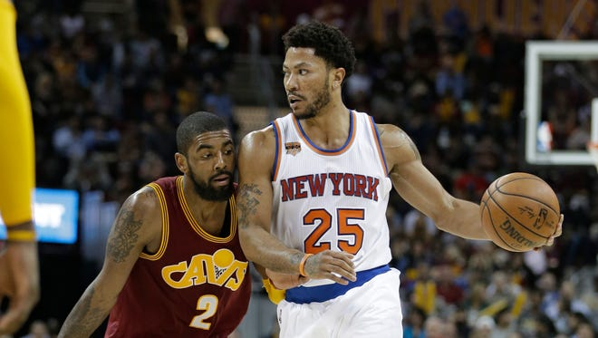 New York Knicks' Derrick Rose (25) drives against Cleveland Cavaliers' Kyrie Irving (2) during a game last week.