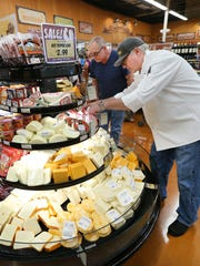 Cheese Supervisor Mark Dank straightens products at