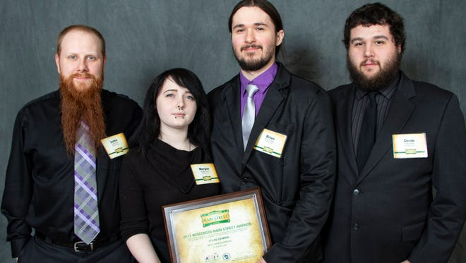 Atlas Gaming was recognized as the Best New Business in the state during the 2018 Wisconsin Main Street Awards at Ripon College. The Atlas Gaming team is pictured, from left: Justin Chase, Store Manager Morgan Crouch, Business Owner Brian Krueger and Derek Wensel.