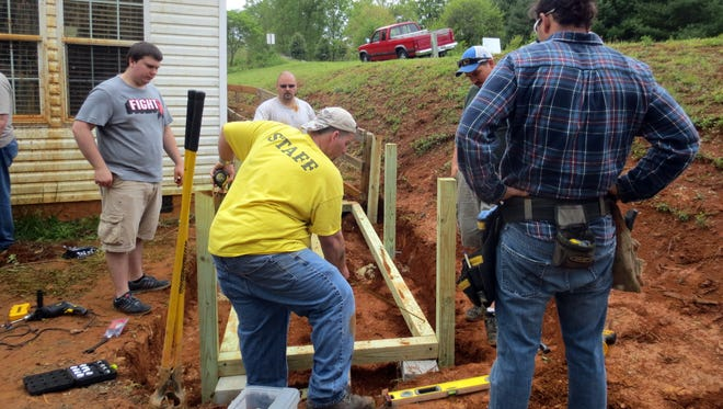 Volunteers at Liberty Baptist Church partner with Mountain Housing Opportunities to build wheelchair ramp for a woman in need. The nonprofit affordable housing developer hosted its 22nd annual Ramp Festival May 7.