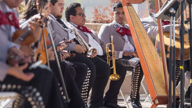 Mariachi Aguilas de Las Cruces takes a break from performing during  Las Cruces International Mariachi Conference Mariachi Mass on Plaza de Las Cruces on Sunday, Nov. 12.