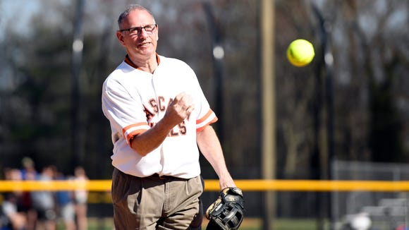 Former Pascack Hills softball head coach Al Taliaferro throws the first pitch on the brand new softball field at Pascack Hills High School in Montvale, NJ on Monday, April 23, 2018.