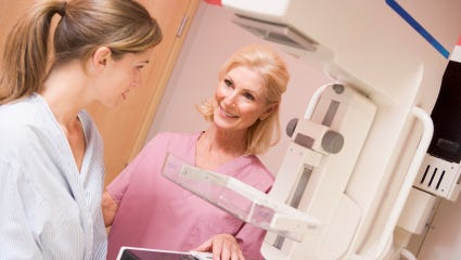 Nurse with patient about to have a mammogram.