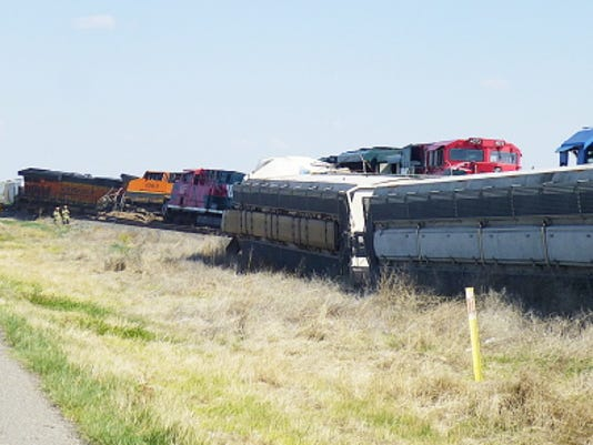 This Tuesday, April 28, 2015 photo provided by the Roswell (N.M.) Police Department shows wreckage of freight trains, southeast of Roswell, N. M. A freight train struck another train head-on early Tuesday in southeastern New Mexico, killing one crew member on the moving train and injuring a second, a railroad official said. (Roswell (N.M.) Police Department via AP)