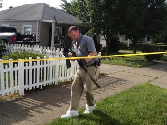 Officials removed at least seven guns from the Hamilton home Wednesday morning.