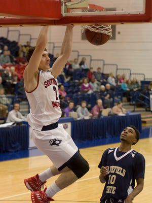 Southern Indiana's Jacob Norman (2) slams one down over Bluefield State's Greg Purnell on Jan. 2, 2017.