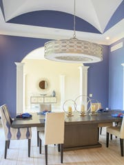 Vaulted ceilings make a statement in the dining area