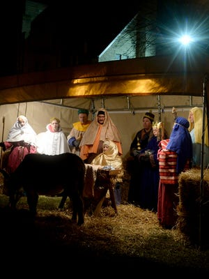 Church members create a live Nativity at First United Methodist Church, 318 National Road W. in Richmond.