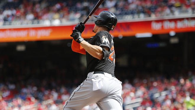 Giancarlo Stanton hits a two-run home run against the Nationals in the first inning of Game 1 of their day-night doubleheader.