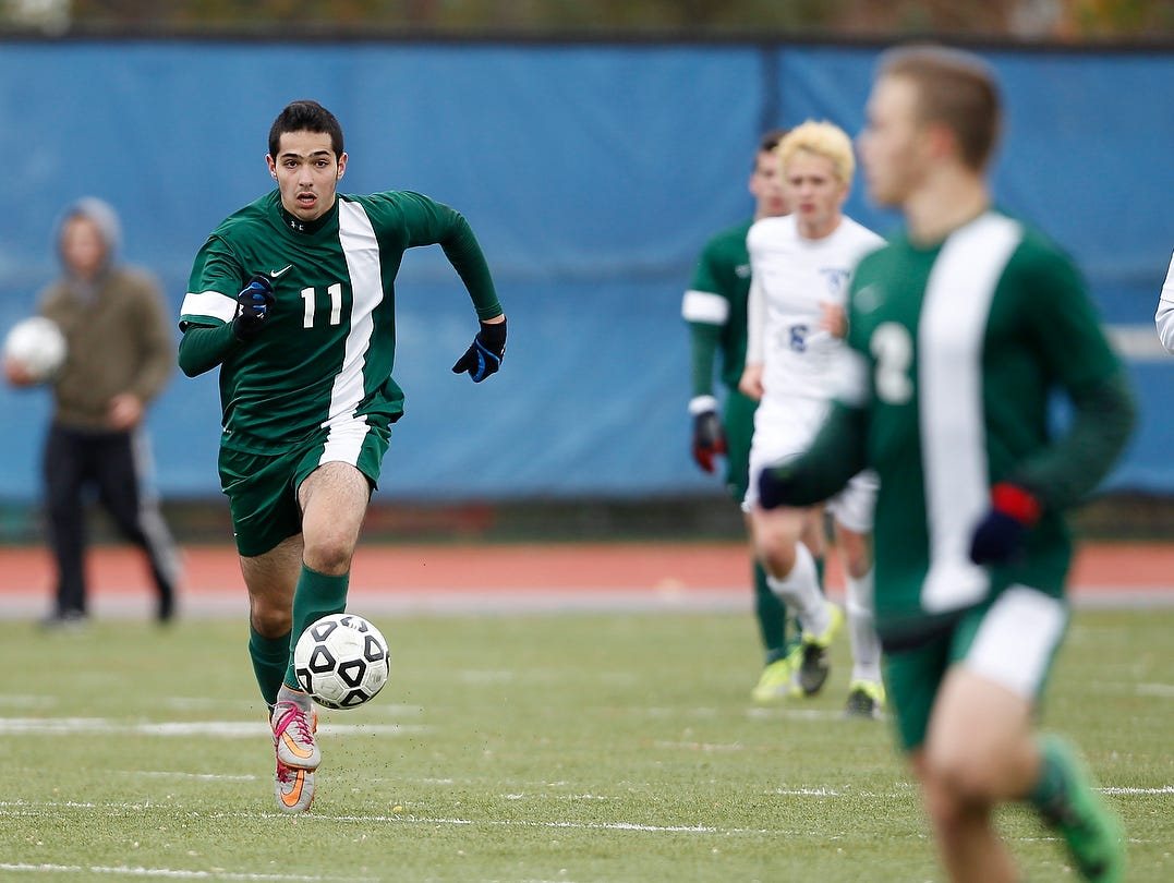 Solomon Schechter's Jonathan Rand (11) looks up for an open pass during their 1-0 win over Geneseo in the NYSPHSAA Class C state semifinal soccer game at Middletown High School on Saturday, Nov. 14, 2015.