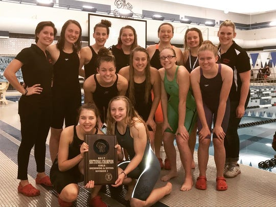 Members of the SPASH girls swimming team are all smiles after capturing the team championship at the Hudson Sectional on Nov. 4.