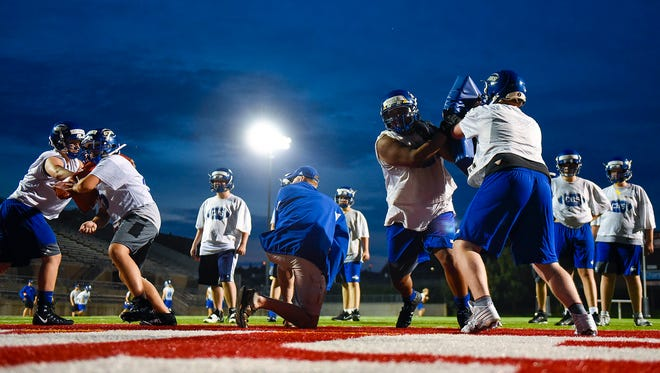 St. Cloud Cathedral works on blocking during practice Tuesday, Aug. 15, at Husky Stadium.