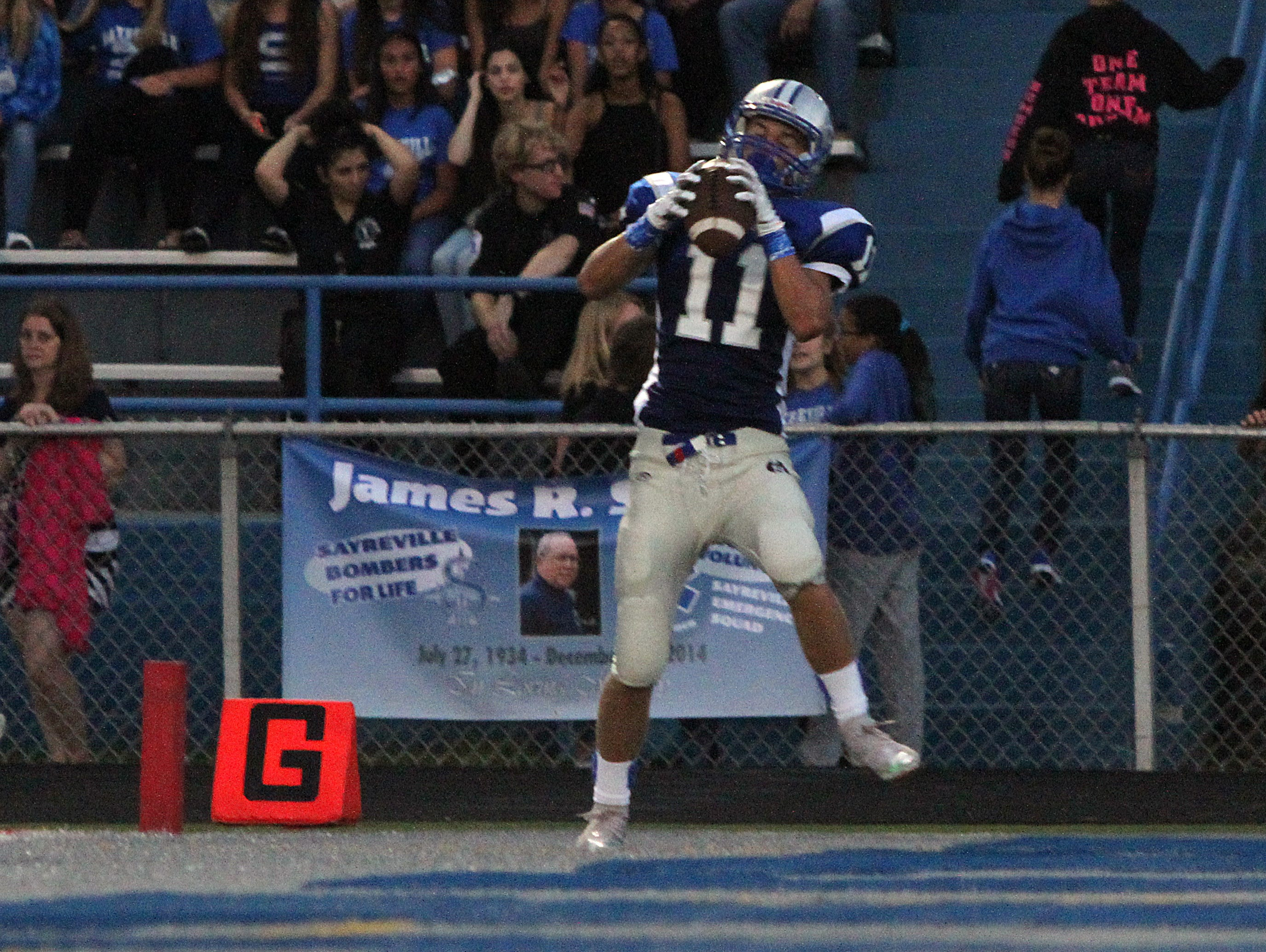 The scandal-ridden Sayreville High School football team returns to action for the first time since school officials cancelled the remainder of the 2014 season last October with their 2015 opener against J.P. Stevens on Friday September 11,2015. Here Sayreville's # 11 Andrew Willie catches a first quarter touchdown pass from Sayreville quarterback # 2 (not seen)-Jayson McMild.