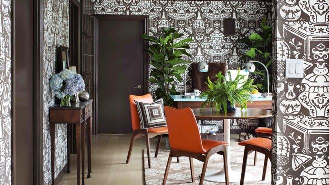 A fiddle leaf fig tree incorporates life into this home office.