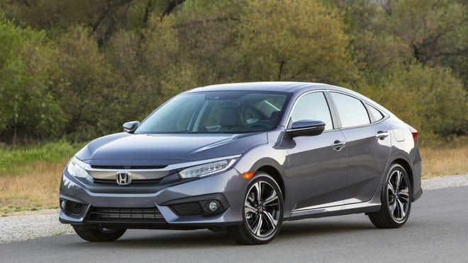 This photo provided by Honda shows the 2017 Honda Civic sedan, for which the average monthly purchase payment was $388 in the first half of 2017, according to Edmunds research. For shoppers who leased the car, the average payment was $266, or 31.5 percent less. Many Americans buy cars, perhaps out of habit, but the trade-in patterns and financial impacts suggest they might be better off leasing. (Courtesy of American Honda Motor Co. Inc. via AP)