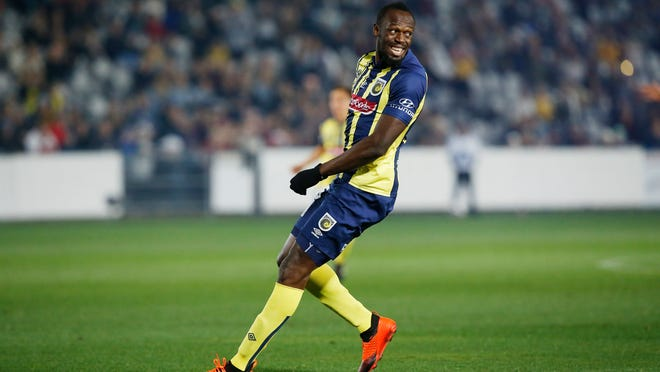 Usain Bolt overruns across the pitch during a friendly trial match between the Central Coast Mariners and the Central Coast Select in Gosford, Australia, Friday, Aug. 31, 2018. Bolt, who holds the world records for the 100- and 200-meter sprints and is an eight-time Olympic gold medalist, is hoping to earn a contract with the Mariners for the 2018-19 season in Australia's top-flight competition. (AP Photo/Steve Christo)