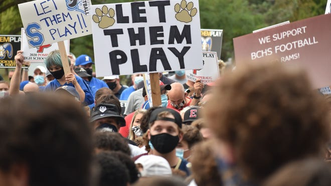 Over 1,000 parents, coaches and players protested the decision to cancel full-contact football games this fall outside of the state capitol building in Hartford.