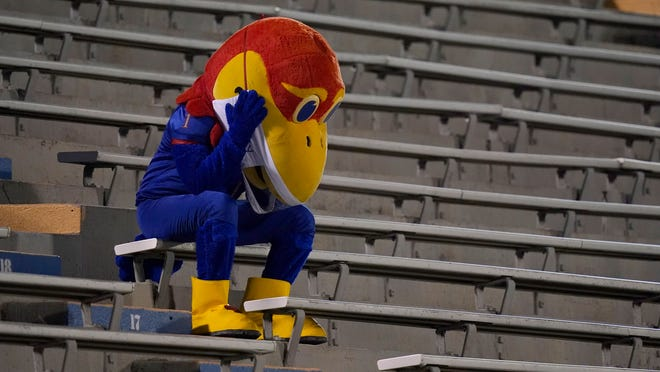 Kansas Jayhawk mascot sits in the empty stands during the second half of Saturday's game against Coastal Carolina.