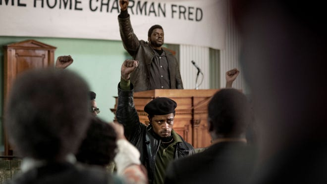 Fred Hampton (Daniel Kaluuya) spreads the word from the dais as Bill O'Neal (LaKeith Stanfield) shows his support.