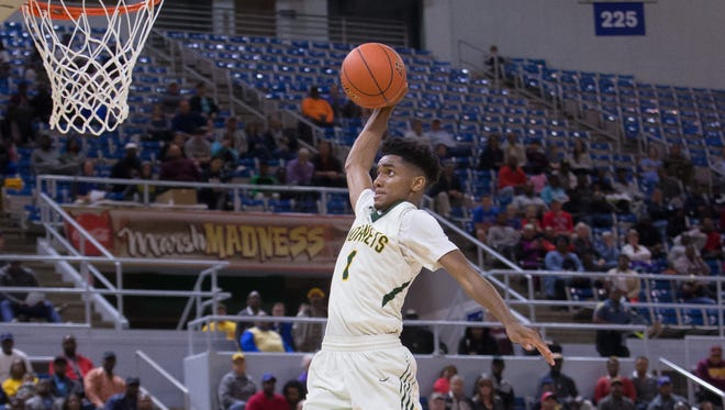 Rayville's Mylik Wilson (1) , a junior, was named the MVP of the Class 2A state championship with 25 points and 10 assists.