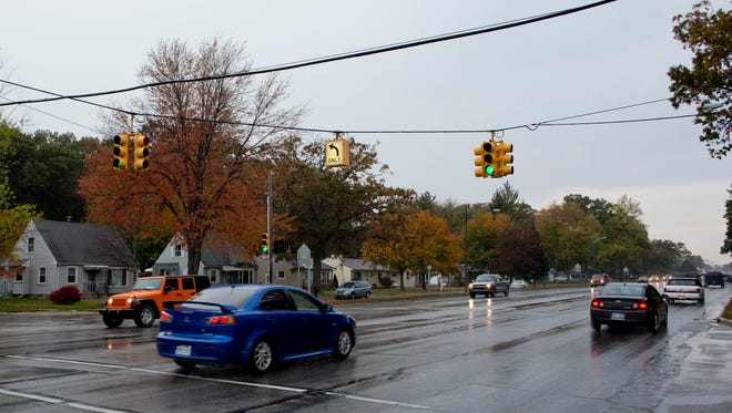 Cars travel along Pine Grove Avenue at Sanborn Street Tuesday, October 20, 2015 in Port Huron. MDOT will improve and create new synchronization on at least nine traffic signals from Sanborn Street to just north of the Fort Gratiot Walmart in 2016.