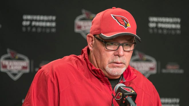 Cardinals Bruce Arians speaks to the press after the first day of camp in Glendale, AZ on July 31, 2015.