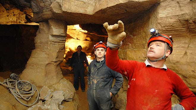 In this file photo, Kasey Fiske and Andy Ebenhoe of Wisconsin Speleological Society look at layers of sediment along the West Passage of the New Hope Cave at Cherney Maribel Caves Park near Maribel in 2007.